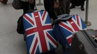 Suitcases decorated with the UK flag