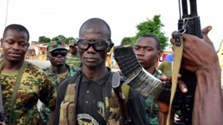 """Mutinous soldier pose with their weapons in the streets of Ivory Coast""""s central second city Bouake, in May 14, 2017"""