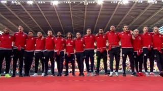 Wales players sing the anthem
