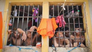 Inmates stand in their cell in the Pedrinhas Prison Complex, the largest penitentiary in Maranhao state,