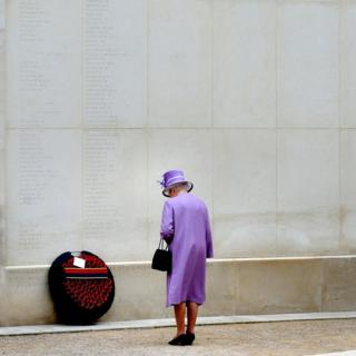 The Queen lays a wreath next to the wall of the Armed Forces Memorial where the of more than 15,000 servicemen and women killed on duty since the end of World War Two are inscribed