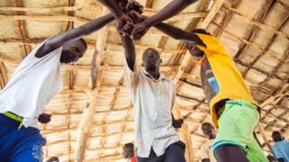 "Young refugees from Sudan practice an activity on ""trauma healing"" at Doro refugee camp, in Maban, South Sudan, on May 3, 2017. The NGO Jesuit Refugee Service provides therapeutic activities for youth who have experienced critical experiences in conflicts, such as in the Blue Nile, in Sudan"
