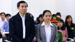 "Vietnamese blogger Nguyen Huu Vinh (L), 60, and his assistant Nguyen Thi Minh Thuy (R), 35, stand trial in a court room at the local People""s Court in Hanoi on March 23, 2016."