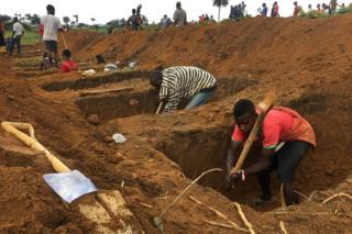 Men digging graves