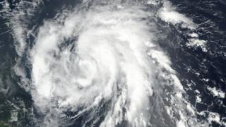 Image shows Hurricane Maria as it approaches the Leeward Islands in the Atlantic Ocean