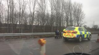 Police stopping man on M74
