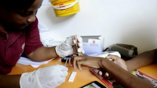 Nurse takes a blood sample on March 8, 2011 in a mobile clinic set up to test students for HIV at Madwaleni high school near Mtubatuba in Kwazulu Natal, South Africa.