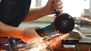 Man using grinder