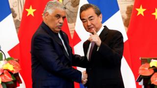 China's Foreign Minister Wang Yi (right) shakes hands with Dominican Republic's Chancellor Miguel Vargas