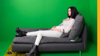 model in front of greenscreen