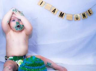 Baby Jared gets stuck into his dairy-free birthday cake