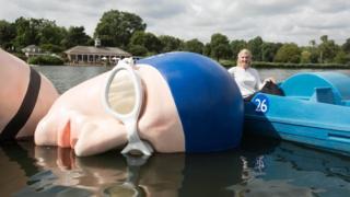 Rebecca Adlington with her floating fibreglass sculpture