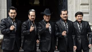 Mexican band Los Tigres del Norte pose before a press conference in Mexico City, on October 7, 2014.