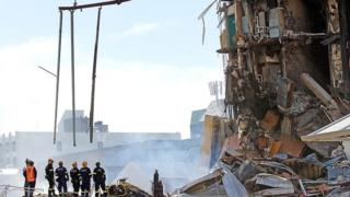 Rescue workers at the collapsed CTV building
