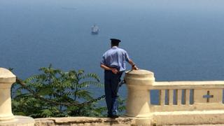 Policeman looking out to sea