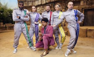 Richard Ayoade with Vicky Pattinson, Lydia Bright, Ore Oduba, Louis Spence and Alex Brooker