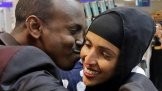 Somali refugee, caught in limbo after first travel ban, kisses his wife at Salt Lake International Airport