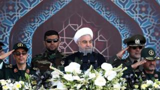 Iranian President Hassan Rouhani attends an armed forces parade in Tehran,