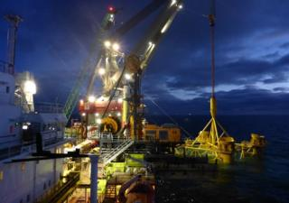 Ship installing first cluster of foundation piles