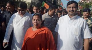Indian Union Minister for Water Resources, River Development and Ganga Rejuvenation Uma Bharti (C) takes part in a rally in Kolkata on October 31, 2015.