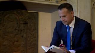 Leo Varadkar prepares to give a speech at Queen's University in Belfast