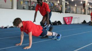 Young rugby players carry out some of the targeted exercises