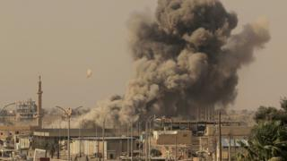 File photo showing US-led coalition air strike on IS position in the Syrian city of Raqqa on 15 August 2017