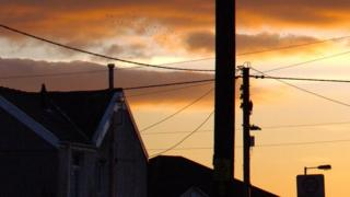 Home with telegraph pole