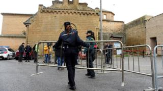 Police officers stand guard at the Monastery of Santa Maria de Sijena, in Huesca, northwest Spain