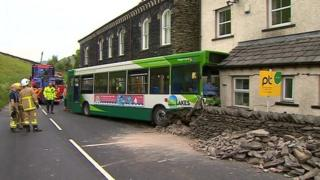 Emergency services assess the damage at the scene of the Tebay bus crash