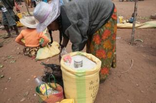 This picture taken in March 2015 shows a street vendor selling rice imported from Pakistan, as a result of the scarcity of non-imported food due to prolonged drought, in the village of Ambonaivo, in the Tsihombe district of southern Madagascar