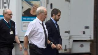 Michael Lane arrived to court handcuffed.