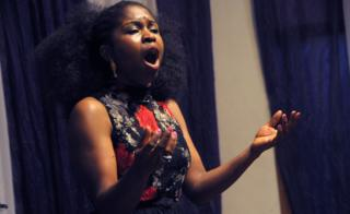 """Nigerian soprano Omo Bello rehearses in Lagos on December 8, 2017. A live performance of an aria from an Italian opera, sung by a professional soprano, isn""""t a common sound in Nigeria""""s bustling commercial and entertainment capital. But it""""s not the strangest thing for the performer, Omo Bello. News of her appearance in Lagos has attracted a crowd, even it""""s only for a short rehearsal."""