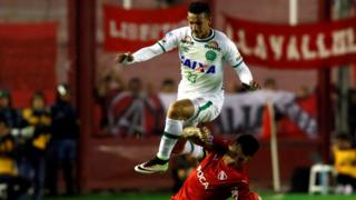 Chapecoense's Lucas Gomes jumps over Independiente's Victor Cuesta, in Buenos Aires, Argentina, on 21 September