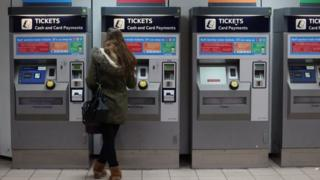 Woman buying train ticket