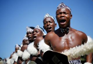 Contestants sing as they begin their routine during the annual Ingoma traditional Zulu dance competition in Durban