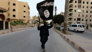 A masked Islamic State militant pictured in 2014 in Syria