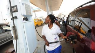 Woman dey sell petrol for filling station