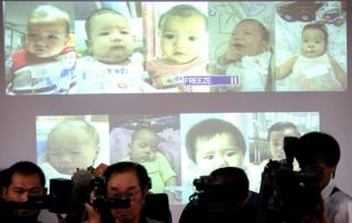 Surrogate babies that Thai police suspect were fathered by a Japanese businessman who has fled from Thailand, 12 August 2014