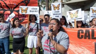 A Daca recipient brought to the US when she was 4-years-old speaks at a Los Angeles rally.