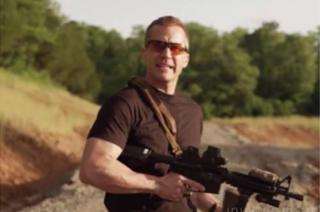 Greitens holding a gun
