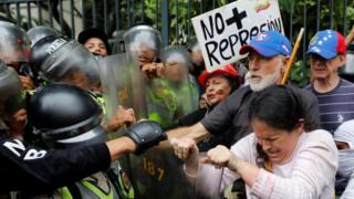 """Demonstrators clash with riot police at """"Grandparents March"""" in Caracas"""