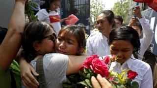 Student activist Ei Thinzar Maung (C) greets her relative during a trial at the TharYarwaddy district court in Bago division, Myanmar, 08 April 2016