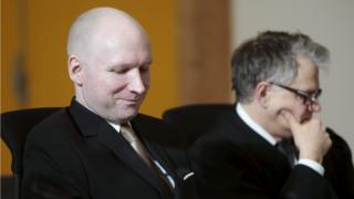 Mass killer Anders Behring Breivik (L) seats by his lawyer Oystein Storrvik inside the court room in Skien prison, March 15, 2016.