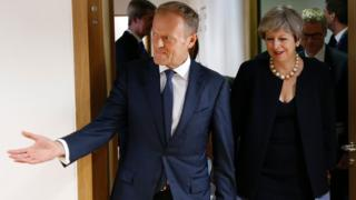 British Prime Minister Theresa May and European Council President Donald Tusk arrive before a meeting a EU leaders summit in Brussels on June 22, 2017