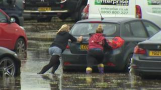cars stuck in rain water and mud at Festival no.6