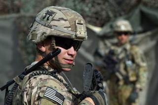 A US soldier stands guard at an Afghan National Army base in the eastern province of Nangarhar