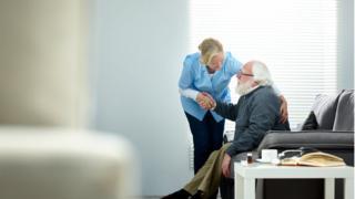 Elderly man with care worker