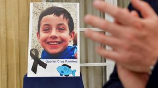 A photograph of young Gabriel Cruz is seen with a black ribbon as a sign of respect at the regional Government headquarters in Almeria