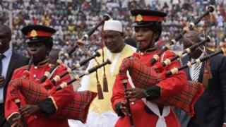 Bagpipe players perform after Gambian President Adama Barrow (C) has taken the oath during his inauguration ceremony in a Banjul stadium, The Gambia - Saturday 18 February 2017